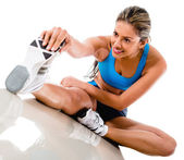 Woman stretching leg — Stockfoto