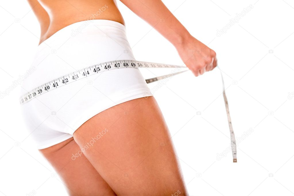 Fit woman measuring her bottom - isolated over a white background — Stock Photo #11465438
