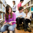 Young at the library — Stock Photo