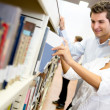 Students looking for a book - Stock Photo