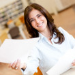 Woman working at the library - Stock Photo