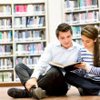 Couple at the library — Stock Photo