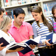 Students holding books — Stock Photo #11505779