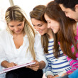 Royalty-Free Stock Photo: Students using a tablet
