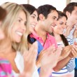Stock Photo: Group of applauding
