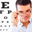 Man taking an eye exam - Stock Photo