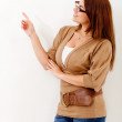 Casual woman pointing — Stock Photo #11508293