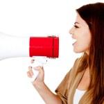 kvinna med en megafon — Stockfoto