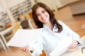 Woman working at the library — Stock Photo