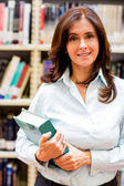 Woman at the library — Stock Photo