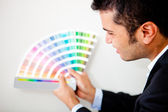 Designer with a color palette — Stock Photo