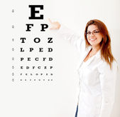 Friendly female optician — Stock Photo