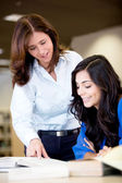 Teacher explaining to a student — Stock Photo