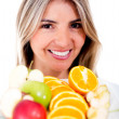 Woman eating fruits — Stock Photo