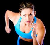 Female athlete running — Stock Photo
