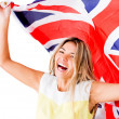 Stock Photo: Happy womwith British flag