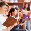Group of students at the library - Stock Photo