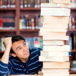 Foto Stock: Overwhelmed male student