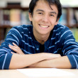 Male student smiling - Stock Photo