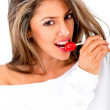 Woman with a lollipop — Stockfoto #11582938