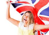 Gelukkige vrouw met britse vlag — Stockfoto