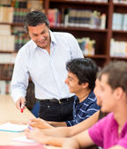 Teacher explaining to students — Stock Photo