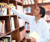 Teacher at the library — Stock Photo