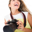 Tourist holding a camera — Stock Photo #11593468