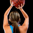 Foto Stock: Basketball player shooting