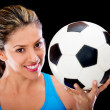Woman holding a soccer ball — Stock Photo