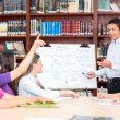 Stock Photo: Teacher explaining subject