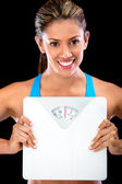 Woman holding a scale — Stock Photo