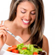 Stock Photo: Woman eating a healthy salad