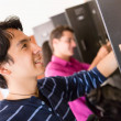 College students at the lockers — Stock Photo #11624885