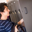 Foto Stock: Student putting things in locker
