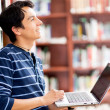 Man researching at the library — Stock Photo #11624923