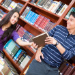 Helpful man at the library — Stock Photo #11624926