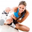 Woman stretching her leg — Stock Photo