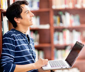 Man researching at the library — Stock Photo