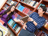 Helpful man at the library — Stock Photo