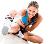 žena protahování nohou — Stock fotografie