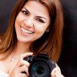 Woman with a digital camera — Stock Photo