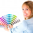 Woman choosing color to paint — Stock Photo