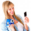 Woman holding a snapshot — Stock Photo #11704030