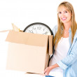 Woman carrying a box — Stock Photo