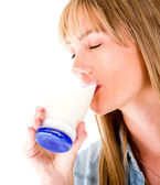 Woman drinking a glass of milk — Stock Photo