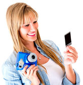 Woman holding a snapshot — Stock Photo