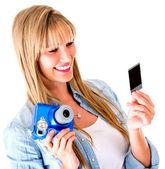 Woman holding a snapshot — Stock Photo