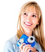 Female photographer with snapshot camera — Stock Photo