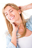 Woman relaxing with music — Stock Photo